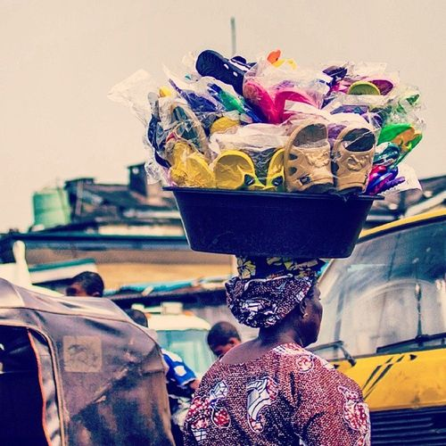 There is nothing you can't buy in a Lagos traffic jam. Goslow Nigeria Streetphotography Africa africanwoman naija snapitoga