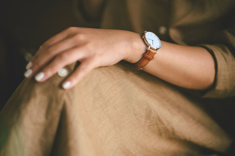 Midsection of woman wearing casuals and wristwatch