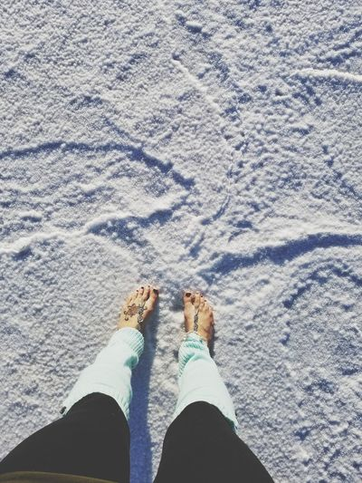 Looks cold, but it's only salt! Personal Perspective Standing One Person Real People Outdoors EyeEm Selects Salt - Mineral Flat Salt Flat Salt Bonneville Salt Flats Utah Tranquility Dusk Beauty In Nature Barefoot Bare Foot Barefoot Sandals Leg Warmers