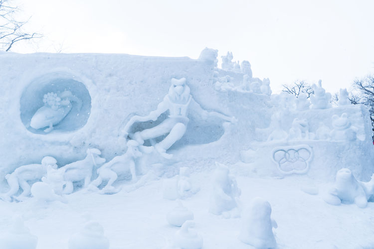 Art And Craft Beauty In Nature Clear Sky Cold Temperature Creativity Day Frozen Human Representation Land Male Likeness Nature No People Outdoors Representation Sculpture Sky Snow White Color Winter
