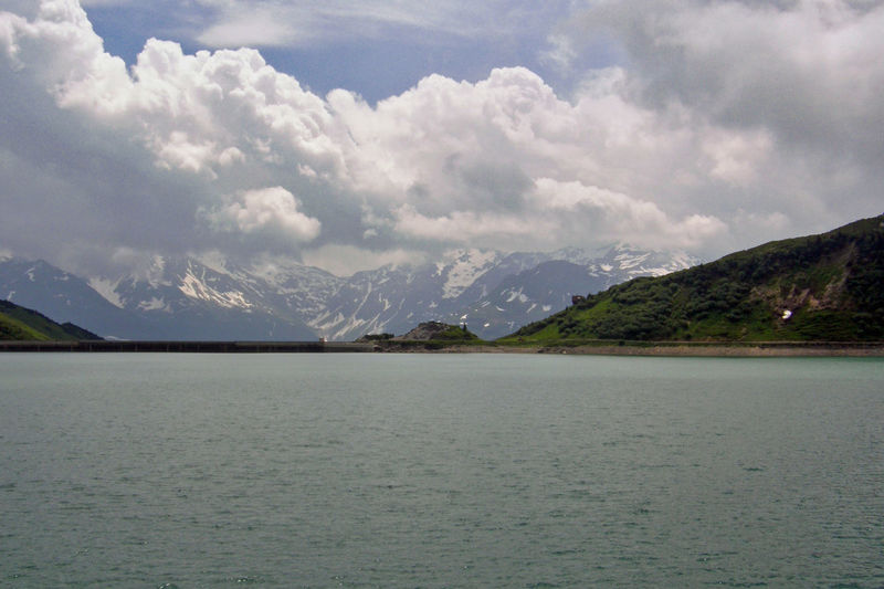 Scenic view of mountains and sea against cloudy sky