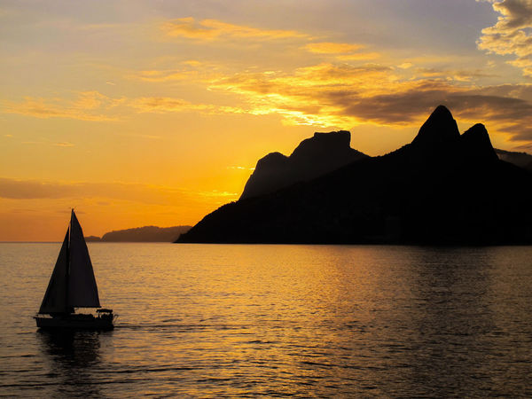 Sunset view from Pedra do Arpoador -Rio de Janeiro - Brazil Beauty In Nature Cloud - Sky Day Ipanema Mountain Nature Nautical Vessel No People Outdoors Pedradoarpoador Riodejaneiro Sailboat Sailboat In Sunset Sea Silhouette Sky Sunset Water