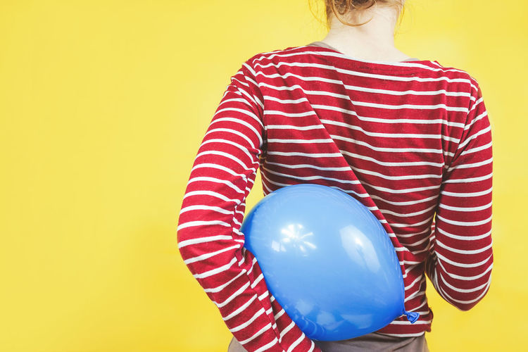 Balloon One Person Studio Shot Colored Background Women Red Holding Indoors  Striped Adult Yellow Sphere Yellow Background Young Adult Standing Copy Space Midsection Cut Out Inflating Hairstyle Backgrounds Childhood Childhood Memories Party Playing Playful Birthday Event Fair Celebration Celebration Event Yellow Flower Red Blue Balloons Ball Plastic Concept Primary Colors
