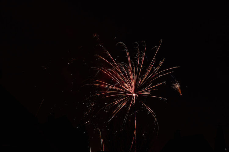 Sylvester 2017/18 Arts Culture And Entertainment Celebration Dark Event Exploding Firework Firework - Man Made Object Firework Display Glowing Illuminated Long Exposure Low Angle View Motion Multi Colored Night No People Outdoors Sky Smoke - Physical Structure Sparks