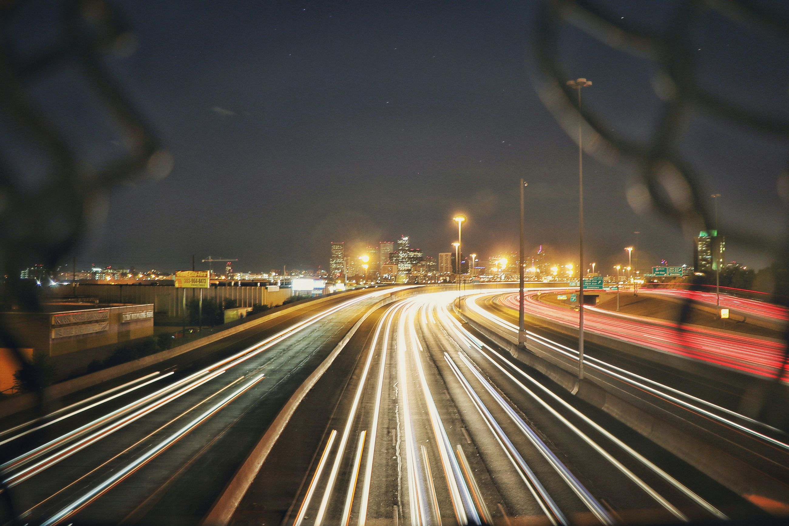 long exposure, light trail, illuminated, night, motion, transportation, speed, high angle view, road, blurred motion, street, street light, city, sky, city life, tail light, outdoors, rush hour, the way forward, journey