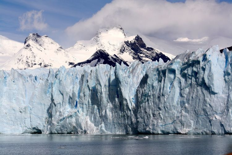 Glaciers at the Bottom of snow covered mountains