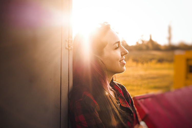 Who's happy here? GrungeStyle Adult Beautiful Woman Beauty Blond Hair Casual Clothing Cheerful City Day Film Photography Happiness Headphones Lens Flare Lifestyles Nature One Person One Woman Only One Young Woman Only Only Women Outdoors People Smiling Sunlight Sunset Young Women