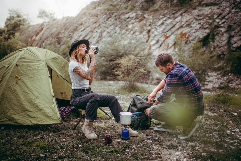 Couple camping in the front of a mountain Tent Tents Mountain Heterosexual Couple Girl Girlfriend Love Fun Summer Vacations Trip Outdoors Camping Abroad Good Vibes Freedom Fresh On Market 2017