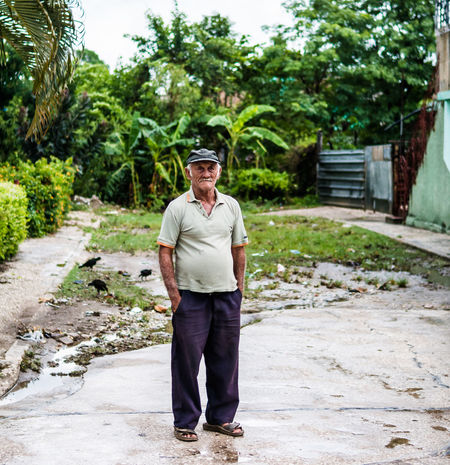 Holguín, Cuba - August 2017: Weathered old man with birds and trash in the background. Alone Communism Cuba Empath EyeEmNewHere Old Man Sandals Weathered Cap Defeated Editorial  Embargo Hands In Pockets Helping Hand Human Outside Raggedy Senior Symbolic  Sympathy Tired Tropical Worn Worn Out Wrinkled EyeEmNewHere EyeEmNewHere Focus On The Story Plastic Environment - LIMEX IMAGINE Be Brave