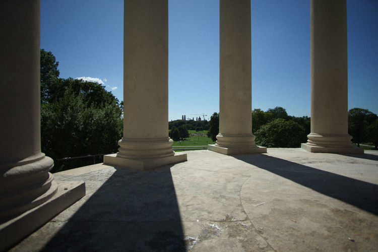 View of colonnade against clear blue sky