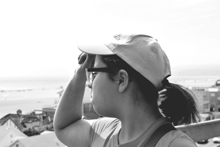 Woman Looking At Sea Against Sky