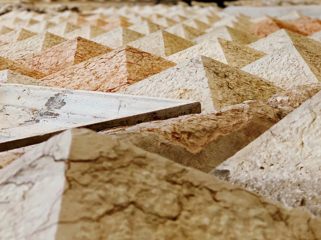no people, close-up, selective focus, indoors, wall - building feature, still life, textured, full frame, paper, day, food and drink, pattern, food, backgrounds, architecture, stone material, marble, wall, concrete