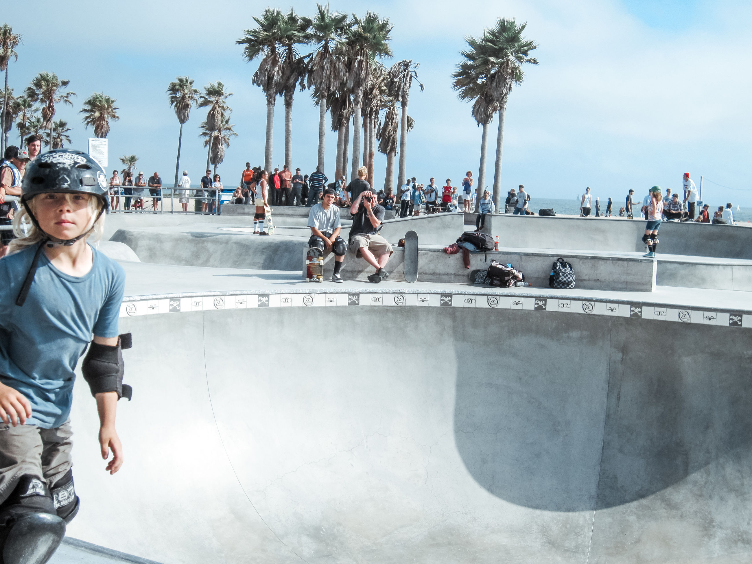 real people, group of people, tropical climate, leisure activity, palm tree, crowd, tree, sky, skateboard park, large group of people, nature, men, lifestyles, skateboard, day, sport, plant, sports ramp, enjoyment, outdoors