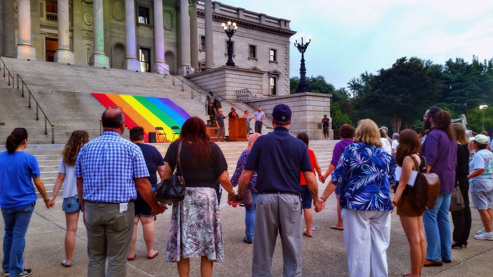Honor Them With Action, 6/12/17 (12/18 in HDR) -- remembering the massacre at Pulse Orlando on 6/12/16. You can see the non-hdr version on my other account: @simplepoetography. -- The Photojournalist - 2017 EyeEm Awards Hdr_Collection Hdr Edit Rally Memorial Women Men People Real People Group Of People Large Group Of People Crowd Architecture Building Building Exterior Built Structure Multi Colored Flag Gay Pride Flag Outdoors Day Sky City Urban