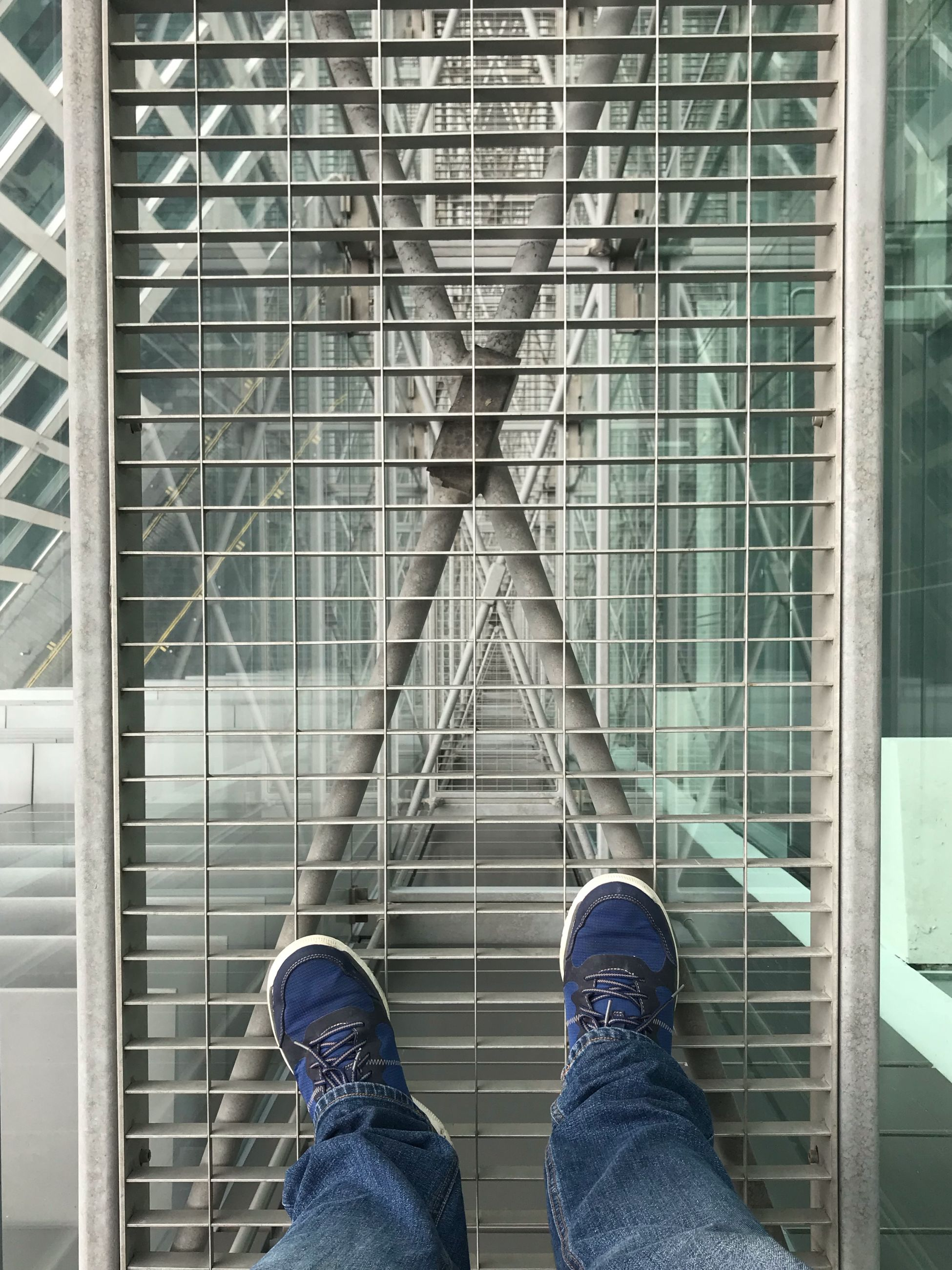 shoe, real people, low section, one person, human leg, body part, human body part, personal perspective, men, built structure, standing, architecture, day, lifestyles, outdoors, jeans, casual clothing, directly above, human foot