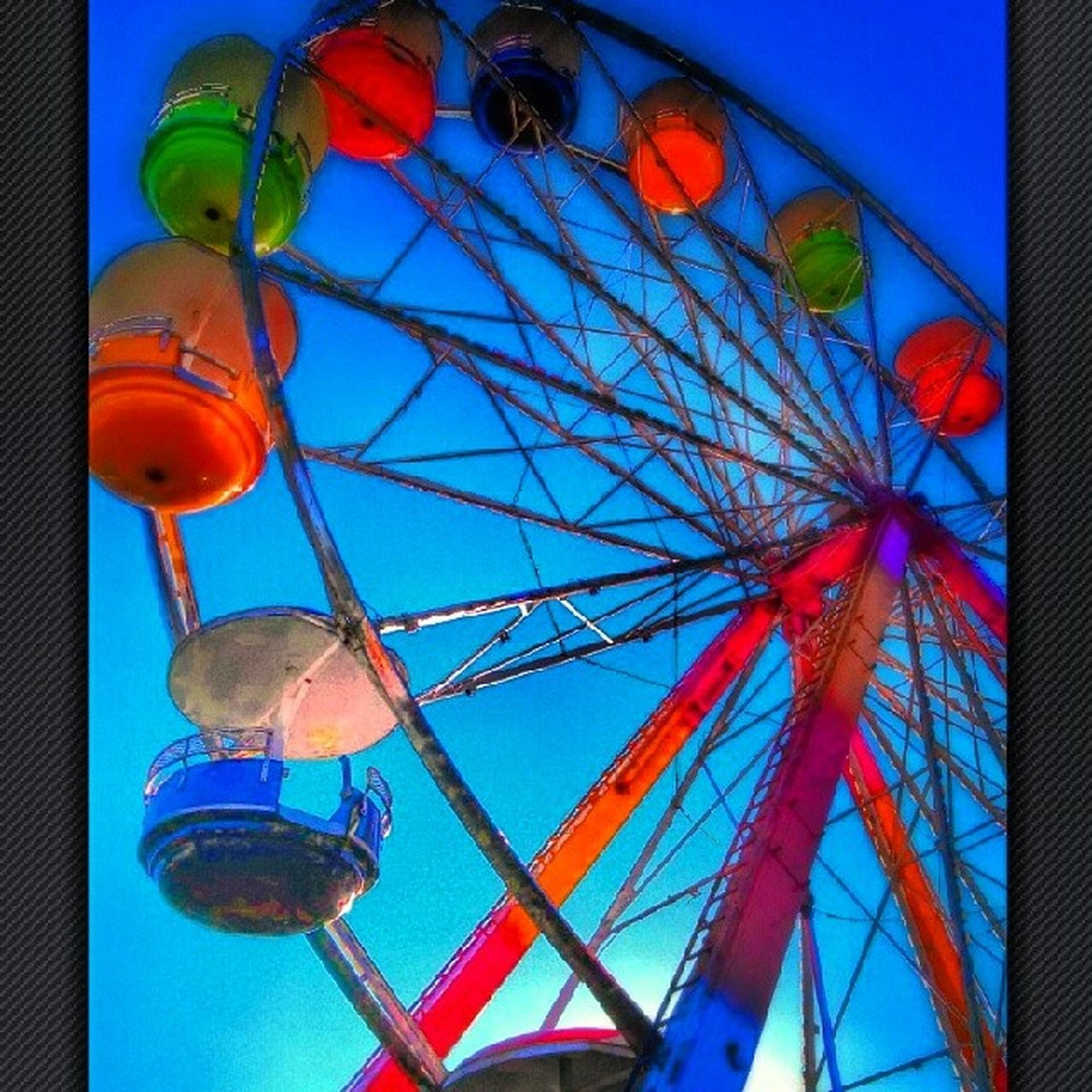 low angle view, amusement park, multi colored, blue, amusement park ride, lighting equipment, ferris wheel, decoration, hanging, metal, arts culture and entertainment, illuminated, built structure, lantern, sky, architecture, no people, clear sky, auto post production filter, outdoors