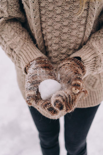 Midsection of person standing in snow