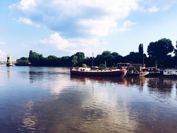 Reflective rivers River Thames Hammersmith Bridge Bridge Hammersmith London Water Sky Nautical Vessel Transportation Tree Cloud - Sky Plant Mode Of Transportation Nature Tranquility Reflection Waterfront Beauty In Nature Day Scenics - Nature Tranquil Scene River Outdoors No People Fishing Boat