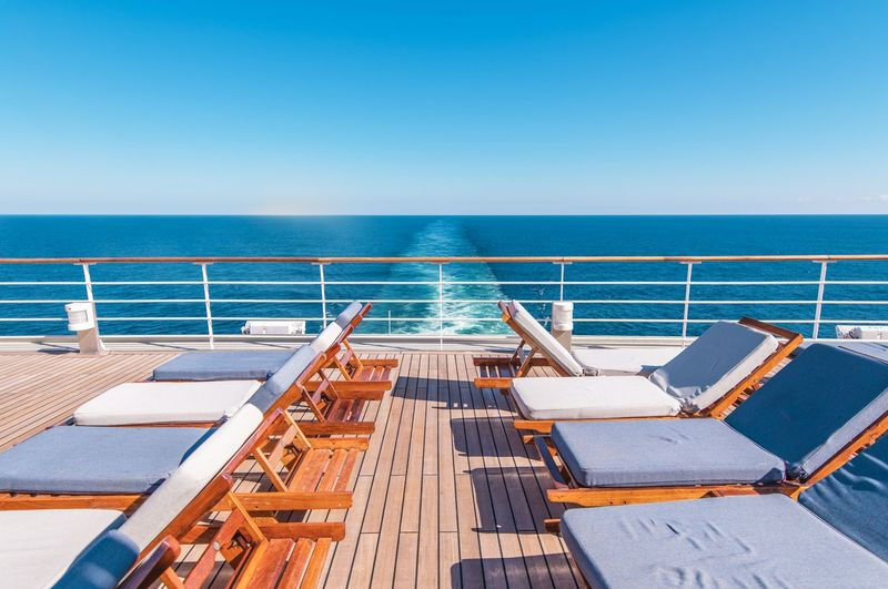 Cruise Ship Vacation. Sea Travel Concept with Deckchairs on the Vessel Deck. Cruise Ship Copy Space Day Deck Deckchair Horizon Horizon Over Water Luxury Modern Nature Nautical Vessel No People Outdoors Scenics Sea Sea Travel Sky Summer Sunlight Sunny Swimming Pool Tranquil Scene Tranquility Vacations Water