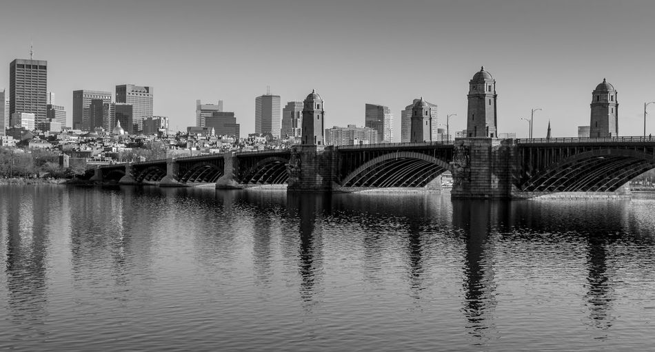 View of the Boston skyline with the Longfellow bridge in the foreground. Black and white photo. Architecture Built Structure City Water Sky Bridge - Man Made Structure River Cityscape Landscape Arch Bridge Boston Longfellow Bridge Salt And Pepper Bridge Charles River Black And White Blackandwhite Clear Sky Skyline