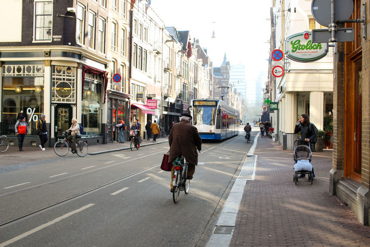 Utrechtsestraat Amsterdam Amsterdam Netherlands Old Man Tram Amsterdamcity Bicycle City City Life Cycling Day Daylight Elderly Man People Real People Street Transportation Urban Utrechtsestraat