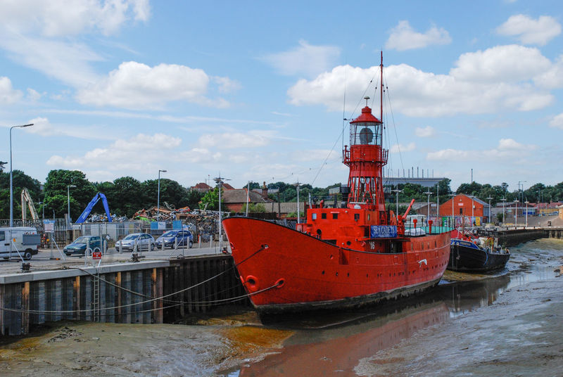 A former Trinity House lightship, LV16, moored alongside King Edward Quay in Colchester. Lightship Beauty In Nature Boat Cloud - Sky Day Harbor Mode Of Transport Moored Nature Nautical Vessel No People Outdoors Sea Sky Transportation Water Waterfront