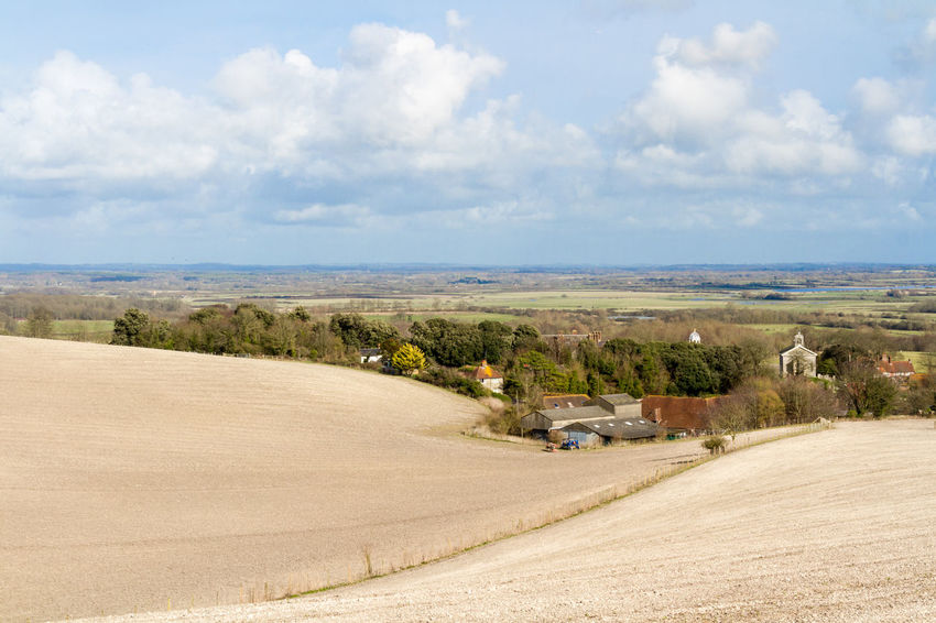 Sussex Landscape Agriculture Beauty In Nature Cloud - Sky Countryside Day Farmland Glynde Horizontal Landscape Landscapes Nature No People Outdoors Ploughed Plowed Scenics Sky South Downs Spring Sussex Travel Destinations Village