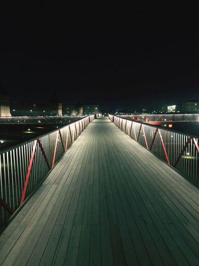 Empty footbridge at night