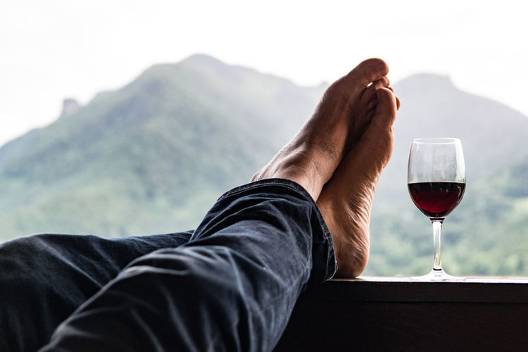 Resting after a day's walk Alcohol Close-up Day Drink Drinking Glass Evening Feet Food And Drink Holding Human Body Part Leisure Activity Lifestyles Men One Man Only One Person Only Men Outdoors People Red Wine Relaxing Time Wine Wineglass Winetasting Wine Moments