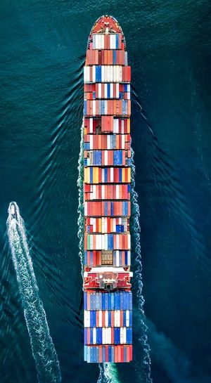 Aerial View Of Cargo Containers On Ship In Sea