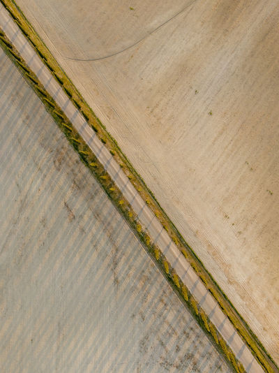 Directly above shot of tire tracks on beach