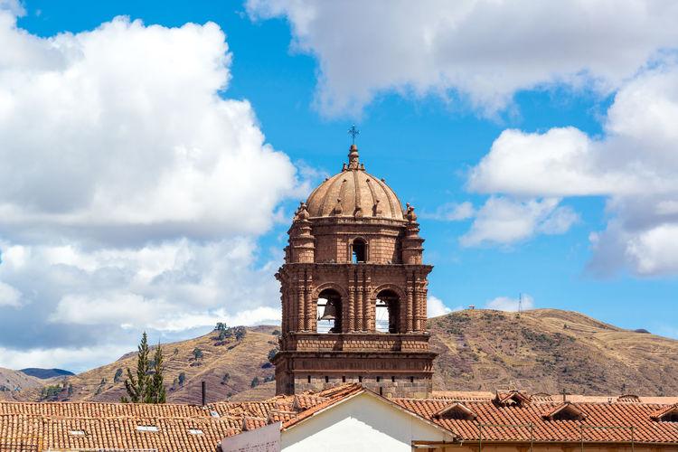View of the tower of Santo Domingo church in Cuzco, Peru Ancient Architecture Art Background Beatuiful Church City Civilization Culture Cusco Cusco, Peru Cuzco Door History Inca Incan Old Peru Peruvian Plaza De Armas Cusco South America Summer Town Travel Wall