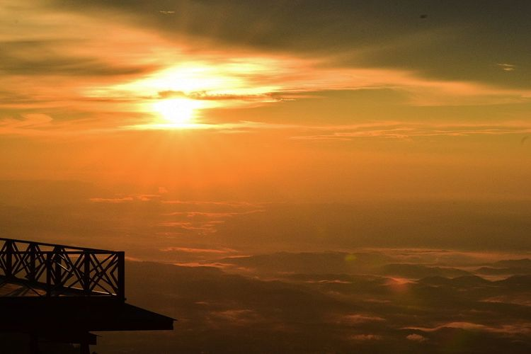 Observation point against cloudy sky during sunset