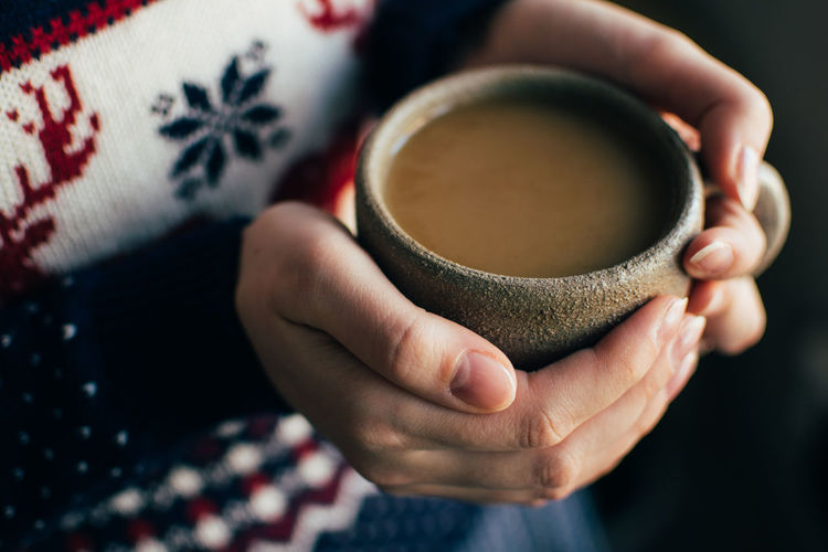 Close-up of woman hand holding tea cup