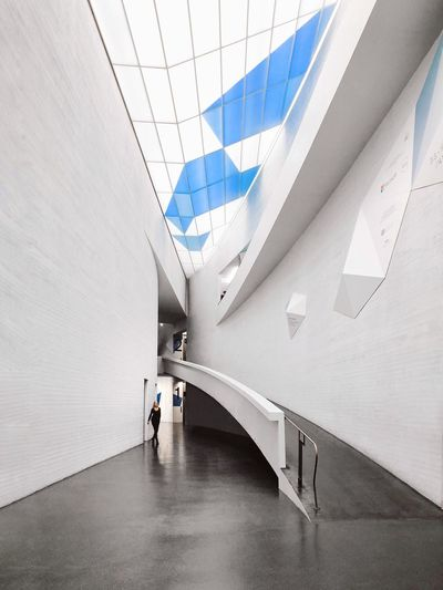 along the curve Minimal Space Blue White Modern Architecture Indoors  Built Structure Walking Futuristic The Graphic City One Person The Architect - 2018 EyeEm Awards