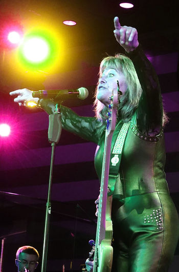 The awesome Suzi Quatro performing live to a huge audience on the MV Magellan cruise ship - Rock the Boat UK 2017 cruise 1960's Rock Group Base Guitar Devil Gate Drive Live On Stage Music Rock The Boat UK 2017 Suzi Quatro Arts Culture And Entertainment Awsome Performance Entertainment Occupation Event Illuminated Indoors  Leather Clothes Leisure Activity Lifestyles Lighting Equipment Microphone Music Musical Instrument Musician Night Nightclub Nightlife One Person Performance Real People Rock Legend Rock Music Singer  Singing Skill  Stage - Performance Space Stage Lighting Young Adult Young Women Youth Culture The Week On EyeEm
