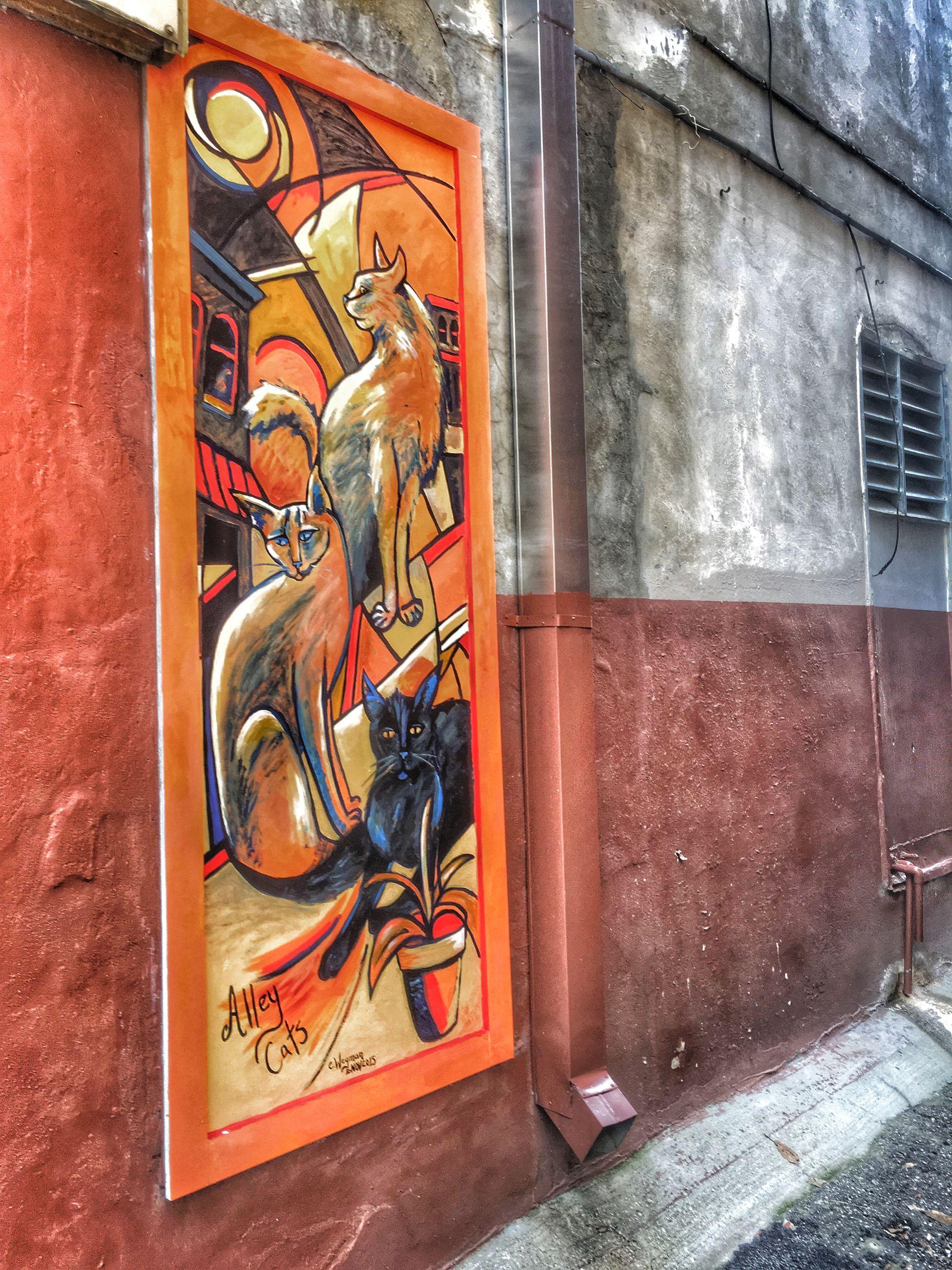 art, art and craft, creativity, human representation, graffiti, wall - building feature, statue, sculpture, building exterior, built structure, architecture, animal representation, wall, brick wall, day, outdoors, door, carving - craft product