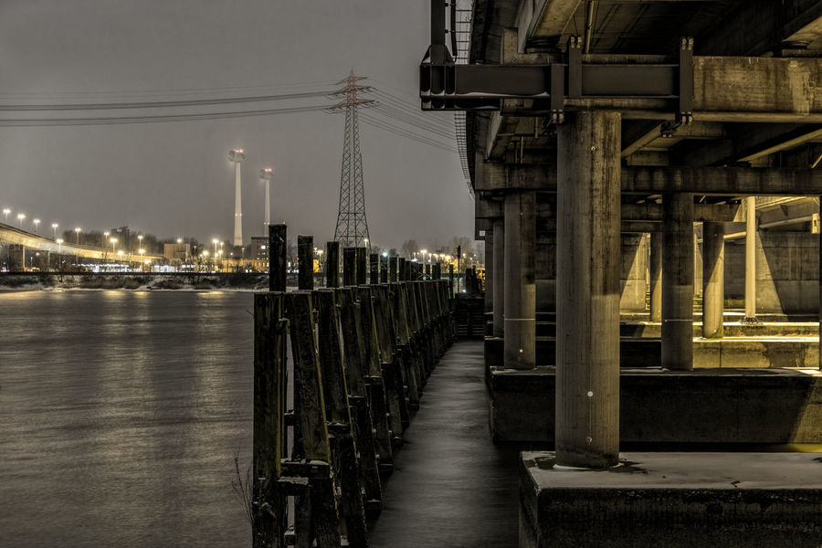 RugenbergerHafen Architecture Built Structure City Collums Connection Diminishing Perspective Empty Engineering Illuminated Long Narrow Nature Night Night Photography No People Outdoors Power Lines Rugenberger Hafen Sky Street Light Under Highway Vanishing Point Walkway Windmills