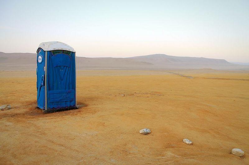 Toilet Against In Desert