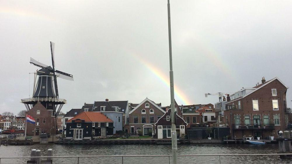 Mooie regenboog met aan de linkerkant molen De Adriaan First Eyeem Photo
