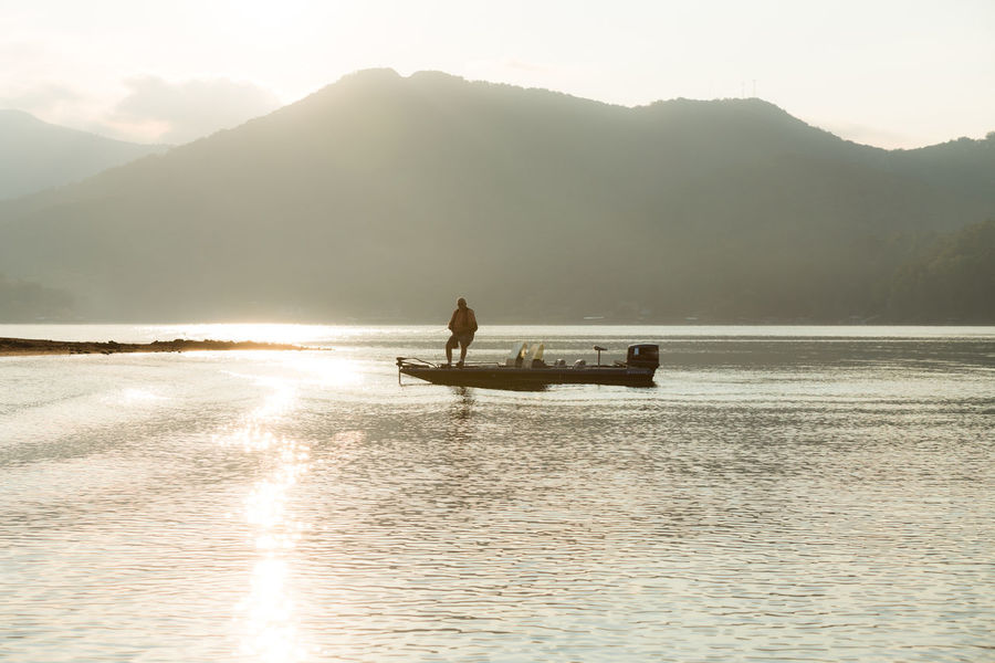 Beauty In Nature Boat Calm Fishing Fog Idyllic Lake Chatuge Majestic Mode Of Transport Mountain Mountain Range Nature Nautical Vessel Outdoors Reflection Rippled Scenics Silhouette Solitude Tranquil Scene Tranquility Transportation Vacations Water Waterfront
