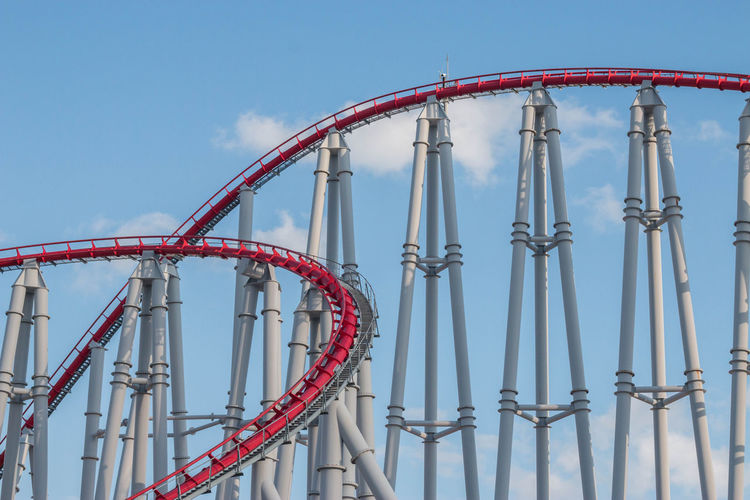 Roller Coaster Amusement Park Amusement Park Ride Architecture Arts Culture And Entertainment Blue Built Structure Clear Sky Day Enjoyment Excitement Fairground Fun Leisure Activity Low Angle View Metal Nature No People Outdoors Railing Red Rollercoaster Sky