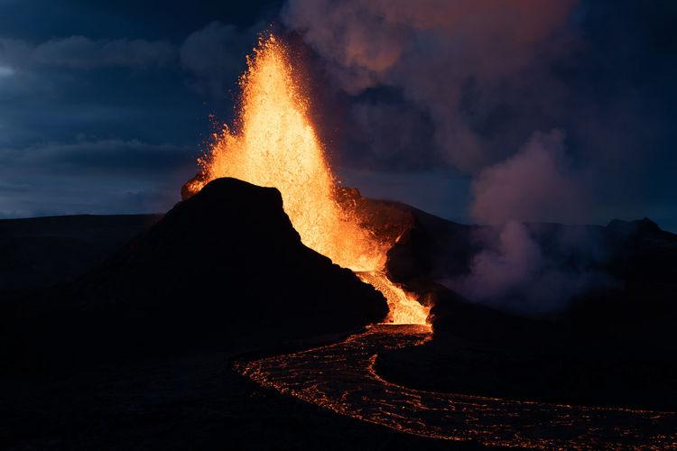 Beautiful volcano eruption and lava river