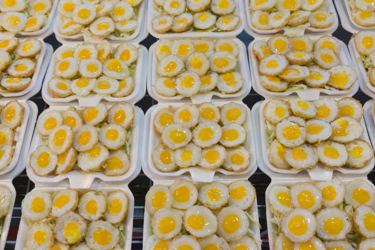 Abundance Arrangement Egg Eggs Food Food And Drink Freshness Fruit Full Frame Healthy Eating In A Row Indoors  Large Group Of Objects No People Order Ready-to-eat Repetition Side By Side Snack Still Life Sweet Food Tray Wellbeing Yellow