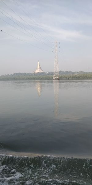 Water Sky Connection Nature No People Waterfront Reflection Cable Tranquility Day Electricity  Electricity Pylon Tranquil Scene Cloud - Sky Bridge Beauty In Nature Built Structure Power Line  Bridge - Man Made Structure Outdoors Power Supply