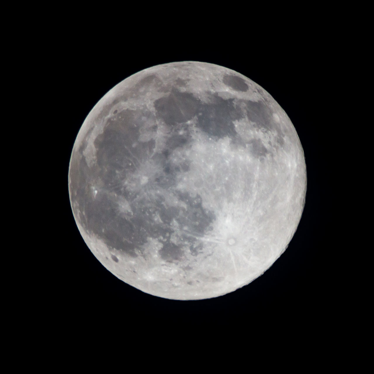 LOW ANGLE VIEW OF FULL MOON AGAINST BLACK SKY