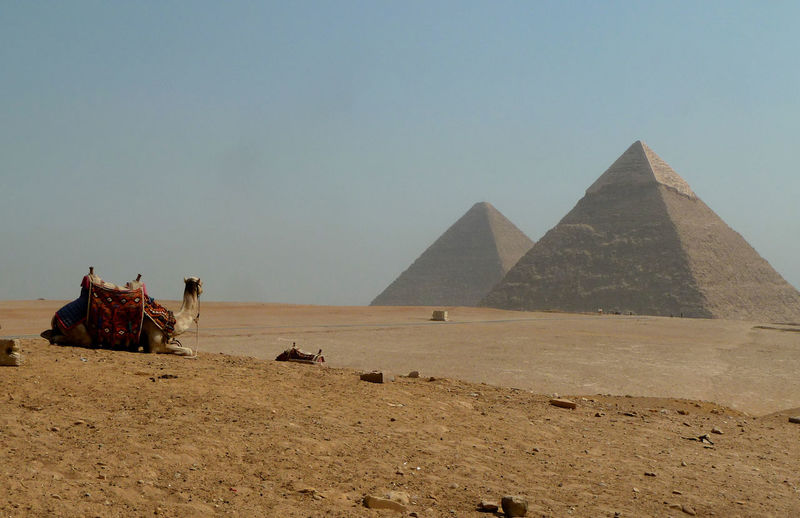 Giza pyramids on desert against clear sky