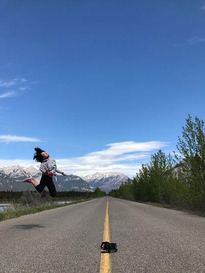 Man on road against sky