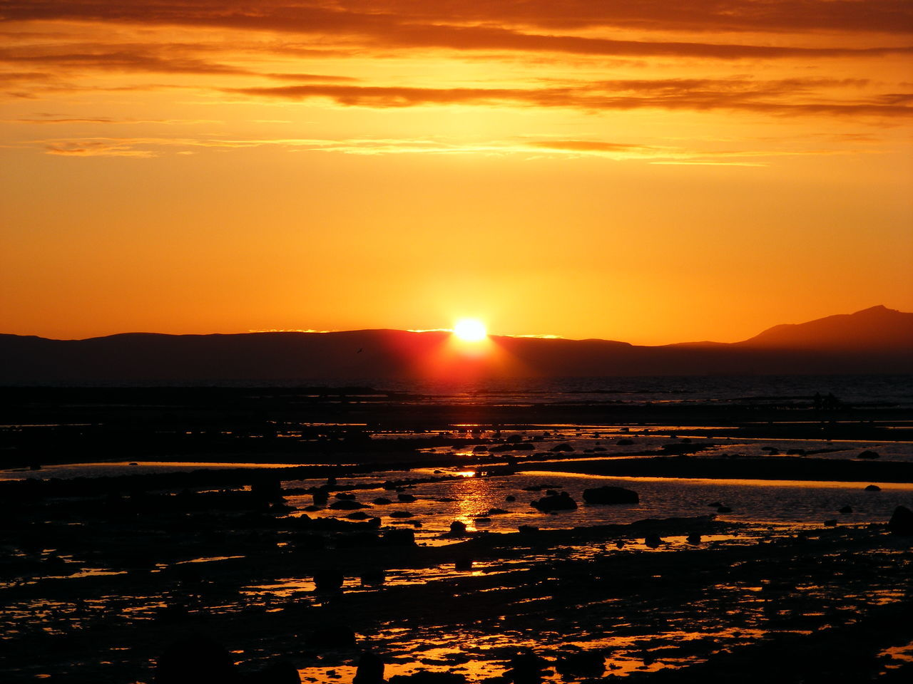sunset, sun, orange color, beauty in nature, nature, scenics, tranquil scene, tranquility, reflection, sky, water, no people, sunlight, silhouette, outdoors, mountain, landscape, sea
