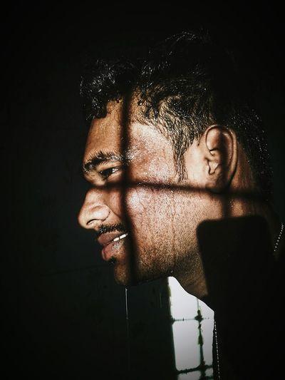 Shadow across man's face